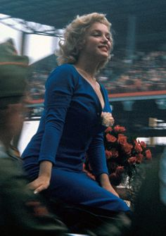 Marilyn Monroe/ she looks like she is just enjoying and taking in all the love of fans