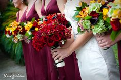 Deep reds, golden yellows and eggplant with bright pops of green for a fall wedding.