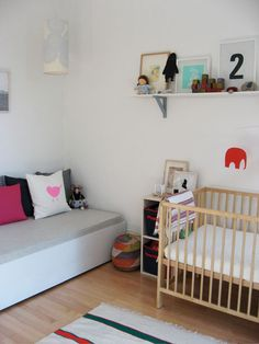 perhaps this is the crib Dan and I can both agree on ;) (not white, not dark, simple design)