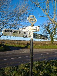 Dorset Fingerpost at Four Ashes. Before restoration. December 2012.