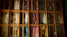 A scarf cabinet ... mmmmm!  Note the sliding part that keeps them corralled.  @ preciouseast.wordpress.com