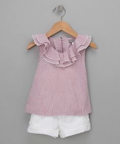 Nothing says sweet quite like this top's ruffled neckline and seersucker material. Its buttoned back and cuffed shorts make it the friendly ensemble for little ladies everywhere.