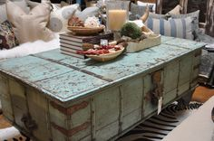 Blue Painted Vintage Trunk Coffee Table or any trunk covered with wood plank or glass would be great as well.