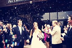 Bubbles instead of rice - what a cool picture! Photo by Angeli #minneapolisweddingphotographer