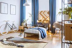 Blue drapes in cozy bedroom. blue drapes and bicycle in cozy bedroom Blue Bedroom Decor, Apartment Bedroom Decor, Bedroom Bed, Cozy Bedroom, Cozy Studio Apartment, Apartment Therapy, Beach Bedding Sets, Armchair Bed, Blue Drapes