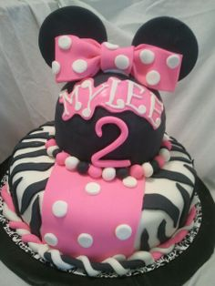 Made by LaKeisha Keck with Sweet Tooth Mother and Daughter cakes. Minnie Mouse and zebra cake.