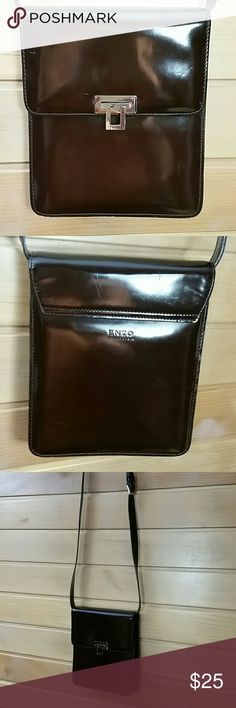 ENZO ANGIOLINI Purse Dark chocolate brown bag by Enzo. 44 inches plus adjustable length of strap. Bag itself is 8 x 7 and opens up about 2.5. The closure is silver and is a clasp over secure. Hard leather, and is in good shape. Enzo Angiolini Bags Shoulder Bags