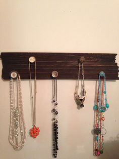 Jewelry holder. Got the knobs from hobby lobby