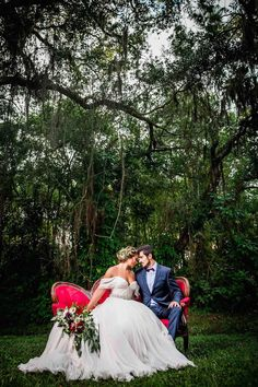 Bride in Amsale Wedding Dress from Blush Bridal Sarasota with Deep Red Burgundy Wedding Bouquet with Greenery on Red Vintage Couch Chaise   Southern Inspired Outdoor Wedding Reception Decor Styled Shoot