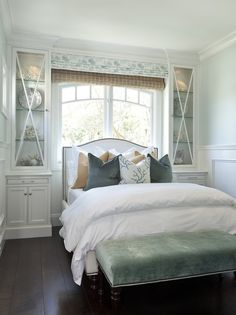 Barclay Butera: Cottage bedroom with white camelback headboard bed with nailhead trim, seafoam green ...