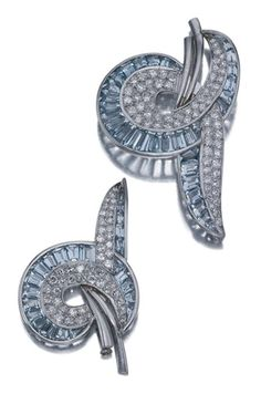 Pair of Aquamarine and Diamond Brooches   Platinum, the brooches fashioned as scrolled ribbons of varied size embellished by 57 tapered rectangular and square-cut aquamarines, pave-set with 118 old European-cut diamonds approximately 4.70 cts., circa 1935