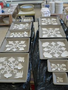 from StudioÉLAN   Etsy.Mud.Team.....could do before firing for texture.....or after firing for resist glaze.....hmmmmm