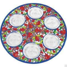 This elegant Seder plate is a wonderful way to bring color to your Pesach table. The aluminum plate is laser-cut in an intricate pattern of intertwining branches laden with hand-painted pomegranates and leaves, evoking abundance and health. Six niches are engraved in Hebrew with the names of the six traditional Passover symbolic foods.