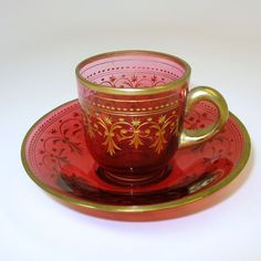Antique gilded cranberry glass cabinet cup and saucer
