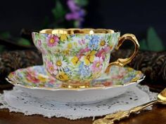 Tea cup/saucer, gold inside and painted flower.t