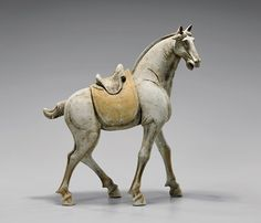 """Large and well rendered, Chinese Tang Dynasty, unglazed pottery horse; in striding motion, with separately modeled saddle, and fancy tied tail; L: 20"""""""