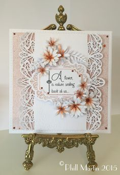 A layout that could be achieved with any pretty border dies or real lace borders and any focal fancy dies & flower diecuts