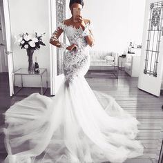Here is a haute couture long sleeve wedding gown that is embellished on the bodice and sleeves. Many brides may not be able to afford this couture dress. But we are US dress makers who can #replica any couture gown. Our version will look very similar in style but will cost less than the original. So if your dream dress is out of your price range email us a picture for pricing. DariusCordell.com