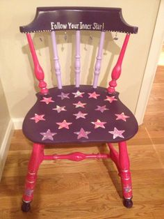 American girl themed chair for kids 5 and older.  Chair reads : follow your inner star.  Open space left above wording so chair can be personalized.  Adorable charms hanging in between back of chair spindles.  Colors include bright pink, dark purple and lavender.  Stars are done with American girl craft paper and are decoupaged with mod podge hard coat sealer.