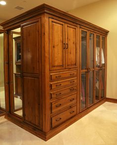 master closet armoire with glass panel doors