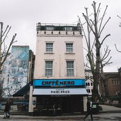 Cutest coffee shop in London. Notice the Fitzrovia Mural by artists Mick Jones and Simon Barber on the left.