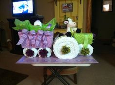 "Another tractor and trailer ""farm girl"" diaper cake; only this one in lavender and green."