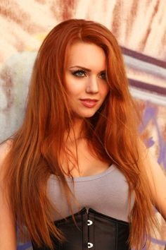 Redhead in grey top and black corset outfit