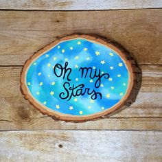 """This adorable hand painted wood slice is inspired by the stars and features the phrase """"Oh My Stars."""" It glows in the dark and would make such cute decor in a baby's nursery. Also makes a perfect gift"""