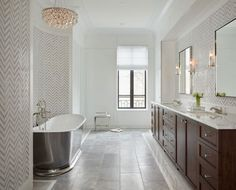 Lincoln Park Transitional Home. A 12,000 sf single family home designed by Kaldec Architecture + Design and built by BGD&C in Lincoln Park, with lavish exterior gardens and roof deck. With over 50 different types of tile and stone, this project and its multitude of details is a true example of strict quality control. Photo by Tony Soluri.     BGD&C Custom Homes, Chicago, IL.  #ChicagoArchitecture #CustomHomes #DesignBuild #Architecture #BeautifulHomes  http://bgdchomes.com/