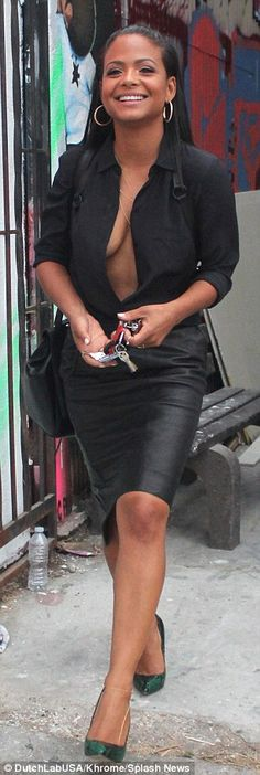 Splash of colour: The songbird teamed her all-black look with a stylish pair of jade green...