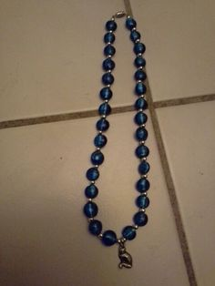 Hand crafted Round Blue Sparkly glass Beaded Necklace with Silver Cat Charm