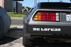 DeLorean outside of the Garage 77 in Los Angeles The Outsiders, Garage, Cars, Carport Garage, Autos, Garages, Car, Automobile, Car Garage