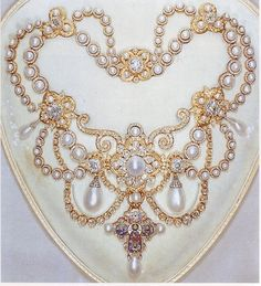 The Dagmar Necklace 1863 - Given by King Frederick VII of Denmark to Princess Alexandra on her marriage to the Prince of Wales (the future King Edward VII) in 1863. It is set with 118 pearls and 2,000 diamonds. The gold and enamel cross is a replica of the twelfth-century Dagmar Cross, now in the National Museum in Copenhagen