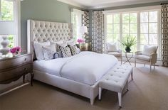 The patterns from the curtains added a cheerful and creative vibe to this white bedroom that has tall French windows.