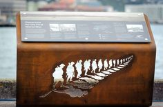 soldier cutouts on angled steel, allowed to rust
