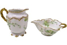 "Elegant signed Haviland & Co. Limoges France sugar and creamer with pink flowers and gold trim. Dimensions: creamer 4.5""H x 4""Dia; sugar, is 6""L x 4.5""W x 2.25""H."