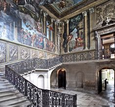 The balustrade to the King's Staircase at Hampton Court Palace was designed and made by the Huguenot ironsmith Jean Tijou. Tijou seems to have arrived in England with William III and Mary II and was active here from about 1688-1712. His most notable work at the Palace was the screen composed of twelve panels, which now bears his name, and can be seen, where it was installed in 1701, at the river end of the Privy Garden.