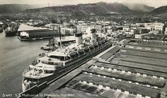 Ocean liner SS Matsonia (ex-Malolo) in Honolulu Harbor, Hawaii, circa 1940. She was later used as a troopship.