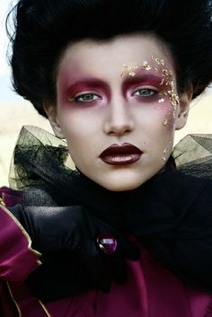 gold leaf look with a deep orchid colored eyes , lightly tinted cheeks and ombre shiny lips.
