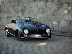 Porsche 356 (1957)  Now that is a good looking car.