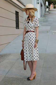 Shop this look on Lookastic:  https://lookastic.com/women/looks/midi-dress-pumps-backpack-hat-belt-sunglasses-bracelet/11279  — White Polka Dot Midi Dress  — Beige Straw Hat  — Black and Gold Sunglasses  — Dark Brown Leather Belt  — Gold Bracelet  — Dark Brown Leather Backpack  — Black and Tan Leather Pumps