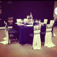 'Murica theme table by Platinum Event Rentals www.platinumeventrentals.com chivalry chair draping done using ivory satin sashes.