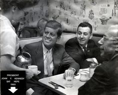 """John F. Kennedy at Jim's Steak and Spaghetti, 1960. Note on back identifies """"Our Phyllis, JFK, David Fox and Ken Hechler."""""""