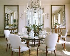 Great #customframed mirrors make this lovely dining room appear much larger than it actually is!