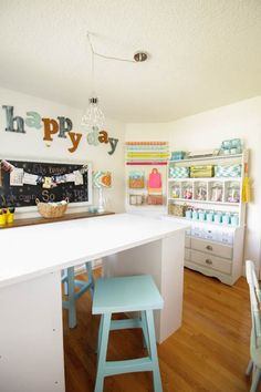 I love this colorful organized craft room makeover at thehappyhousie.com