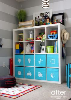 Colored Boxes and Open Shelving, Contemporary Playroom with interior wallpaper, Built-in bookshelf, Carpet, Pendant light