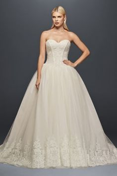 The combination of a structured, figure-flattering corset and a tulle skirt edged in ornate lace appliques creates a wedding dress that is both glamorous and romantic.   Truly Zac Posen, exclusively a