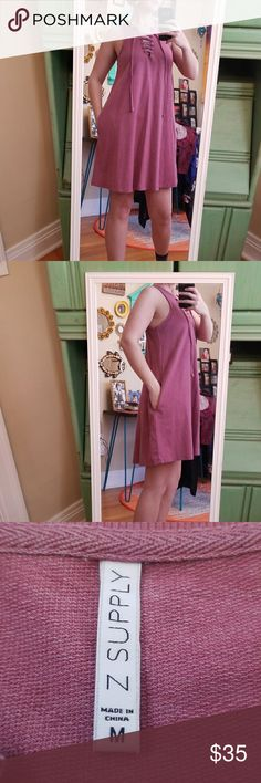 NWOT Z Supply Pink Babydoll Dress!😍 Bought this and never wore it NWOT. No flaws. Super cute and comfy! Color is a pink/purple color (hard to describe). Has a criss cross tie in front on chest and the dress has pockets! Tank top style straps. Babydoll style dress that flares at bottom midi length. Perfect for spring and summer! Size M!😍 z supply Dresses Midi