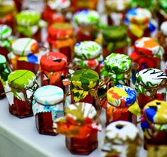 another favor idea i love- vintage fabric on mini jars of jam and jelly.