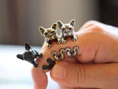 A super realistic animal ring made in the shape of a French Bulldog in shiny silver! This little puppy is super adorable and looks like it's wrapped around your finger, you can even see the pads of its feet! Material: Enamel Plated Tin Alloy Please allow 2 weeks for delivery.
